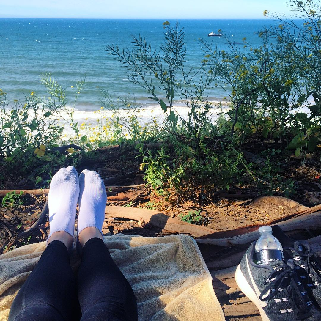 feet, shoes, overlooking beach